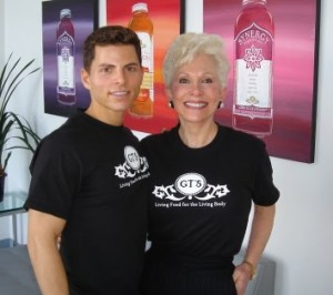 Synergy Kombucha founder Gt Dave poses for a picture with his Mother, whose succeessful battle with cancer he atttributes to his product, at Millenium Products Headquarters.