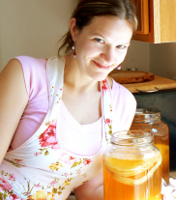 "Hannah Crum, The Kombucha Mamma and a jar of Kombucha Cultures, also known as SCOBYs, ""symbiotic culture of bacteria and yeast"""