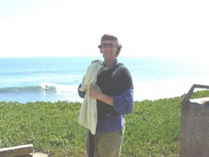 Adam Goodman and his newborn son Asher by the Santa Cruz coastline in 2007