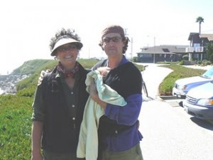 Adam Goodman of Kombucha Botanica and Carrie Lee Toder of Imagics Graphics stand near the Santa Cruz coastline in 2007