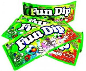 Packages of Fun Dip, candy sticks dipped in sugar, by Wonka candies.