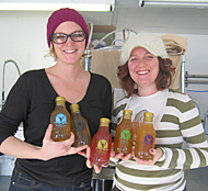 Vanessa and Alla of NessAlla Kombucha in Madison Wisconsin proudly hold cold bottles of their entire NessAlla Kombucha line.
