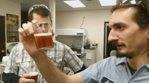 John Laffler of Goose Island Brewery examines a glass of Fleur, the Kombucha Beer