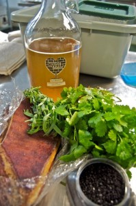 Rose Black House Kombucha used to flavor bacon with bunches of  cilantro at the first Propser Dinner at the House Kombucha Brewery