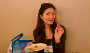 Rachel Avalon holds up her wooden fork that she brought to the Natural Products Expo West 2011