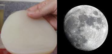 A SCOBY is next to an image of the full moon