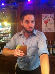 Corey Schellek, bar manager at Culture Shock and creator of Kombucha Cocktail Recipes offers up a glass of Dark & Devoted Kombucha Cocktail.