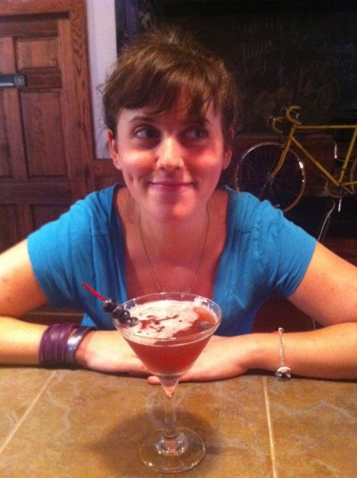 Marian Flaxman, owner of Culture Shock, a fermented foods cafe in Ithaca, NY, poses with her favorite Kombucha Cocktail, The Twisted Bliss