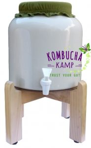 Modern Porcelain Brewing Vessel for Kombucha in white with Light Natural Stand